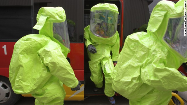 Emergency service personnel wearing chemical protective clothing participate in an anti-chemical warfare exercise on Tuesday, April 16 in Seoul. Tensions remain high in the Korean Peninsula in the wake of North Korea's recent nuclear threats and provocations. A Pentagon intelligence assessment suggests the North may have the ability to deliver a nuclear weapon with a ballistic missile, though the reliability is believed to be &quot;low.&quot;