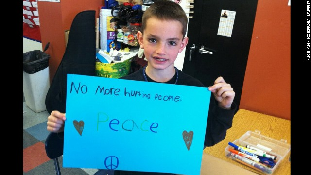 Martin Richard, the 8-year-old killed during the Boston Marathon bombings, holds a sign calling for peace.