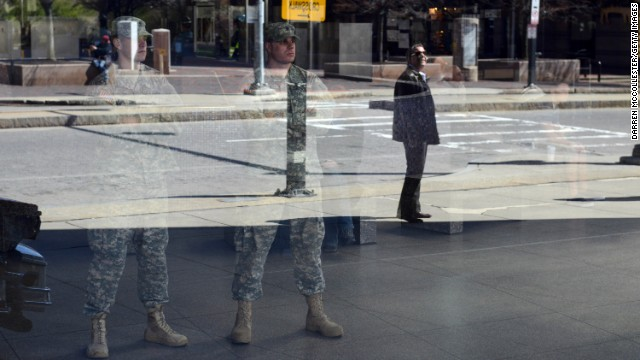 National Guardsmen look out from inside Boston's Back Bay Station on April 16.