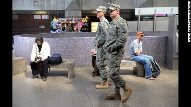 National Guardsmen patrol the Back Bay Station on April 16 as security remains tight in Boston.