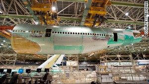 Boeing builds two 747-8s each month at the company\'s massive assembly facility outside Seattle.