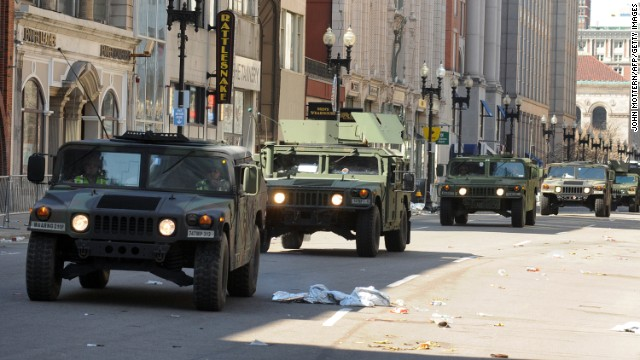 U.S. military Humvees move down deserted Boylston Street on April 16.