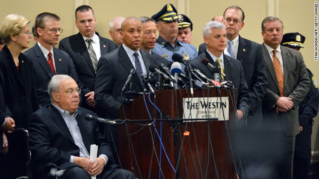 Massachusetts Gov. Deval Patrick speaks at a press conference about the bombings on Tuesday. From left, Sen. Elizabeth Warren, FBI Special Agent in charge of Boston Richard Deslauriers, and Boston Mayor Thomas Menino, seated at front left.