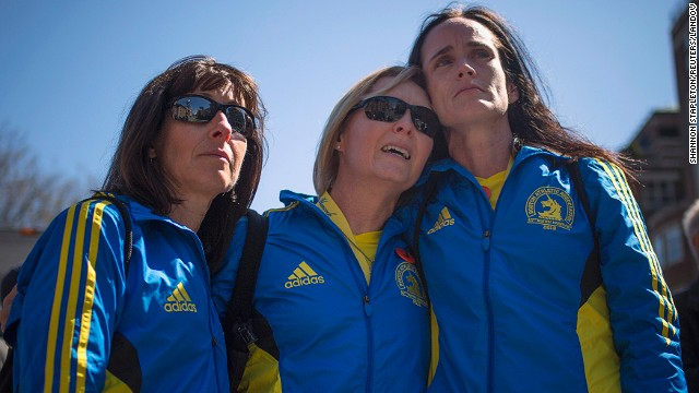 From left, Boston Marathon runners Tammy Snyder, Diane Deigmann and Lisa Kresky-Griffin embrace at the barricaded entrance to Boylston Street near the finish line of the Boston Marathon on April 16.
