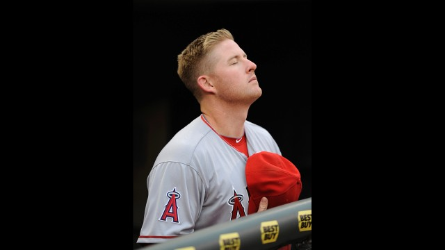 Mark Trumbo of the Los Angeles Angels of Anaheim stands during the National Anthem following a moment of silence to honor the victims of the Boston Marathon bombing before the game against the Minnesota Twins on April 15, 2013 in Minneapolis, Minnesota. <a href='http://www.cnn.com/SPECIALS/us/boston-bombings-galleries/index.html'>See all photography related to the Boston bombings.</a>