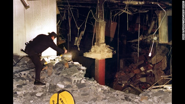 A police photographer helps document the bombing of the underground parking garage at the World Trade Center, which killed six people in 1993.