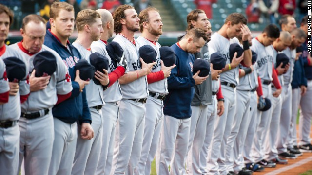 Members of the Boston Red Sox observe a moment of silence before their game against the Cleveland Indians on April 16 in Cleveland.