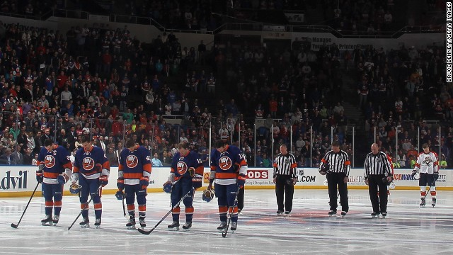 The New York Islanders and Florida Panthers stand for a moment of silence for the bombings at the Boston Marathon before their game at Nassau Veterans Memorial Coliseum on April 16 in Uniondale, New York.