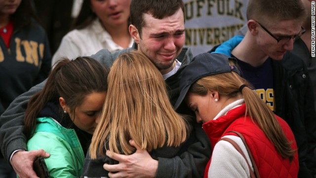 Mourners hug one another during a vigil for victims of the Boston Marathon bombings at Boston Common
