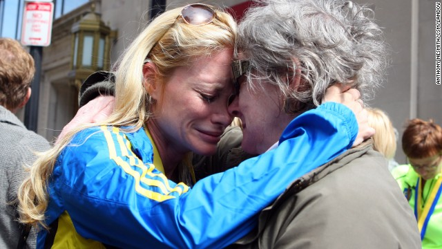 Nicole Rand, left, who ran the marathon, embraces with her mother, Maureen Joham, on April 16 as she recounts her experience in Boston.