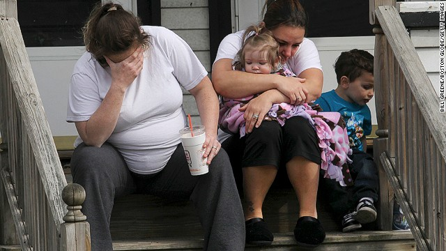 On the shared porch of their home in Medford, Massachusetts, on April 16, Colleen Howe, left, and Lisa O'Leary grieve for their neighbor, Patty Campbell, who lost her daughter Krystle Campbell in the bombings.
