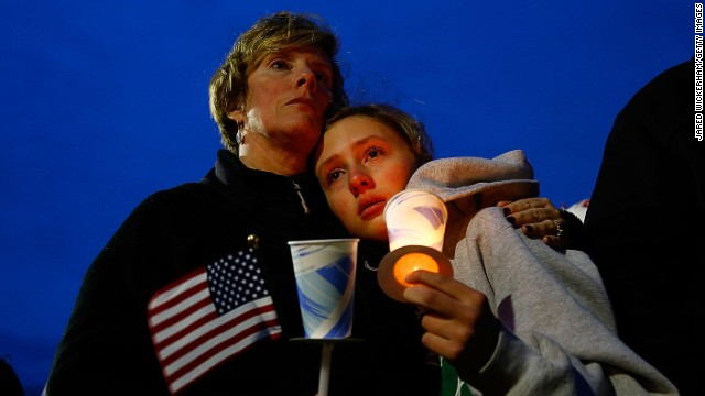A mother and daughter hold one another during a vigil in memory of 8-year-old Martin Richard of Dorchester at Garvey Park in Boston on Tuesday, April 16.