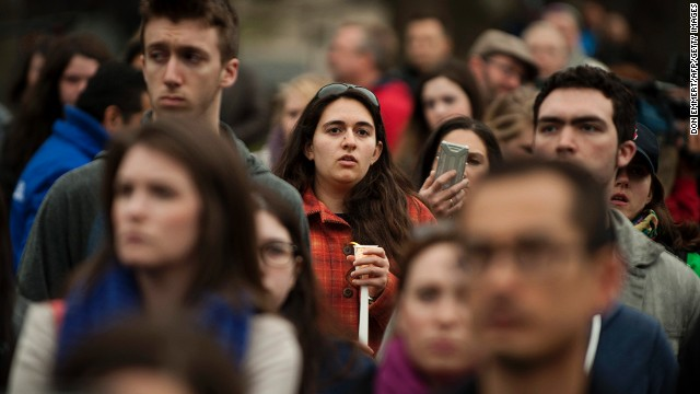 People gather in Boston Common on April 16 for a candlelight vigil for victims of the bombings in Boston.