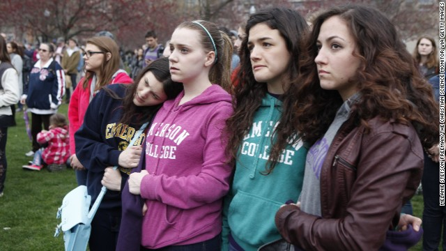Emerson College students embrace one another at the vigil on Boston Common on April 16.