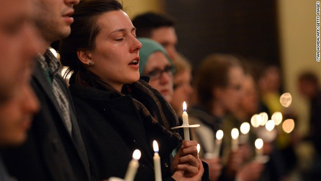 Attendees hold candles in honor of the victims at an interfaith service at Arlington Street Church in Boston on April 16.