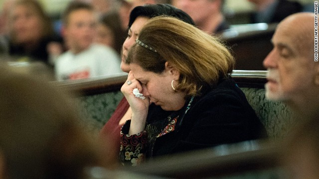 Visitors fill Arlington Street Church for a candlelight vigil on April 16.