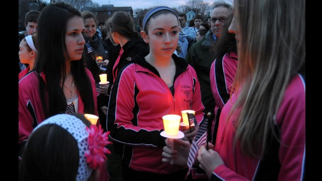 Students from the Clifden Academy hold an American flag and candles during a vigil on April 16 in Dorcester, Massachusetts, in honor of 8-year-old Martin Richard, who was killed in the bombings.