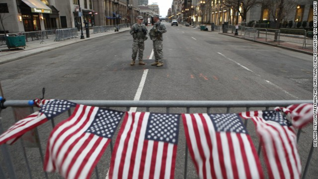 American flags hang from a barrier on April 16 at a roadblock staffed by National Guard soldiers at the end of Boylston Street near the site of the bombings in Boston.