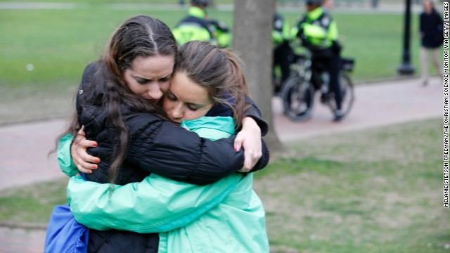 Emerson College students Rachel Ferullo, left, and Kathryn Waxman at a vigil on Boston Common for victims of the bombings.