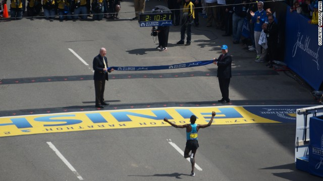 Ethiopian runner Lelisa Desisa, who won the marathon, reaches the finish line.