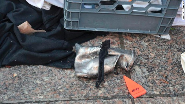A federal law enforcement source with firsthand knowledge of the investigation told CNN that a lid to a pressure cooker thought to have been used in the bombings had been found on a roof of a building near the scene.