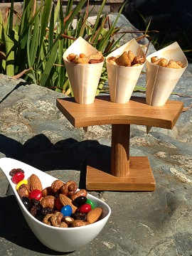 At Lucy Restaurant & Bar in Yountville, California, chef Victor Scargle serves snacks you've never tasted before, like cayenne/chili flake and kaffir lime popcorn and sweet energy trail mix made with butter toffee nuts, peanuts, cashews, pecans, almonds, chocolate and raisins.