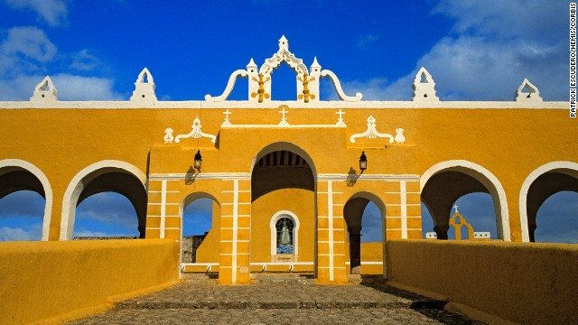 The colonial buildings of Izamal, Mexico, are awash in a vivid yellow that gives the town a sunny look no matter what the weather.