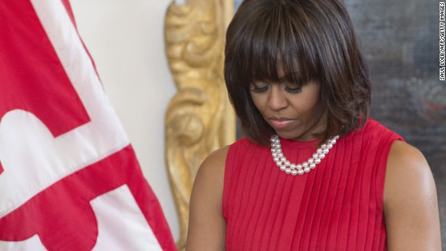 First lady Michelle Obama takes part in a moment of silence for victims of the bombings at the Boston Marathon during a bill-signing ceremony at the Maryland State House in Annapolis, Maryland, on April 17.