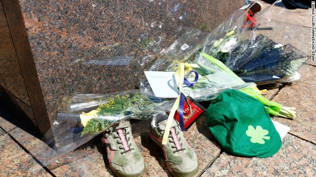 Flowers, running shoes and other items are left in memory of Chinese graduate student Lingzi Lu, who was killed during the bomb explosions on April 17.