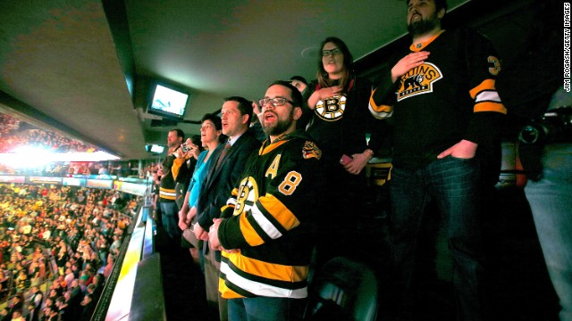 Boston Bruins fans sing the national anthem during pregame ceremonies on April 17 in remembrance of the Boston Marathon bombing victims.