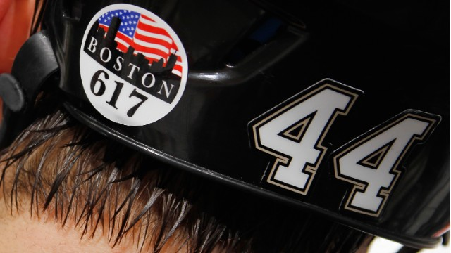 Brooks Orpik of the Pittsburgh Penguins shows his support for Boston with a sticker on his helmet during the Penguins' game against the Montreal Canadiens on April 17.
