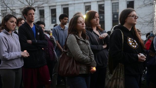 People pray during a vigil held by the city of Cambridge, Massachusetts, on April 17 to show support for those affected by the Boston Marathon bombings.