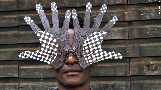 "The self-taught artist, pictured wearing his creations, is best known for his ""C-Stunners"" range, a series of eye-catching handmade spectacles."