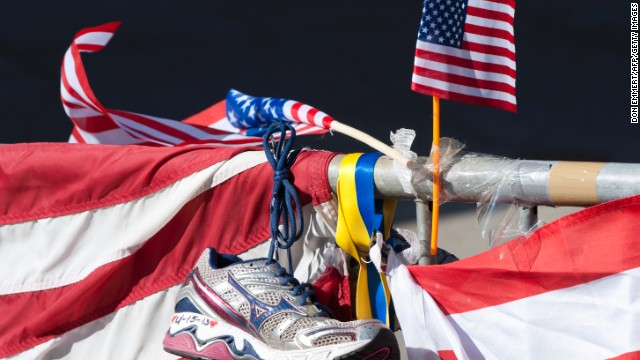 A running shoe and U.S. flag are part of a memorial on the Boston Marathon route on April 18.