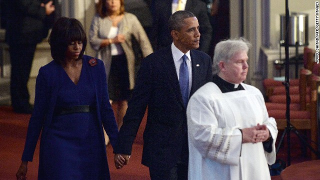 President Barack Obama and first lady Michelle Obama arrive at the interfaith service for the victims of the Boston Marathon bombing, at the Cathedral of the Holy Cross in Boston, on April 18.