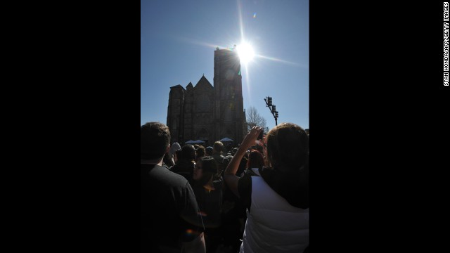 People gather outside of the Cathedral of the Holy Cross.