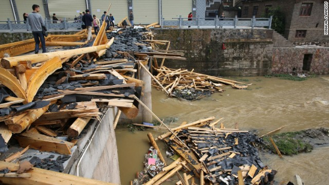 Debris litters a river after a tornado and hailstorm hit Zhenyuan County in China's southwest Guizhou Province on April 18.