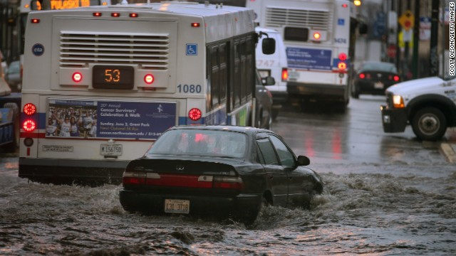 A motorist drives through a flooded underpass In Chicago on April 18. The National Weather Service issued a flash flood warning Thursday for much of the Chicago area, which got 3 to 5 inches of rain in 24 hours with more expected.