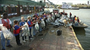 Volunteers in Memphis, Tennessee, sort out the garbage from a recent Mississippi River cleanup.
