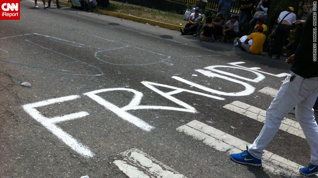 Opposition protesters made their feelings clear in this road graffiti, as seen in iReporter Manuel Sosa's <a href='http://ireport.cnn.com/docs/DOC-957810'>image from Merida</a>, western Venezuela