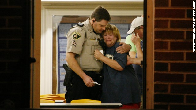 A sheriff's deputy comforts a woman at a command post on April 18.