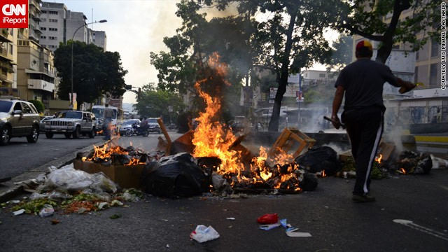 Protests have rocked Venezuela following Sunday's election, apparently won by the late president Hugo Chavez's designated successor, Nicolas Maduro. This image from <a href='http://ireport.cnn.com/docs/DOC-957922'>Luis Miguel Bastardo</a> shows burning trash and tires on a Caracas Street.