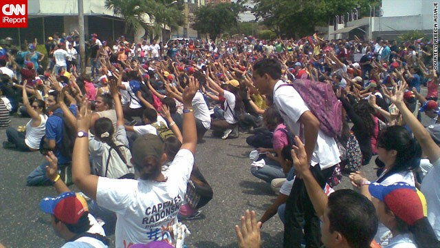 Also in Barquisimeto, medical student <a href='http://ireport.cnn.com/docs/DOC-958057'>Rebeca Asuaje</a> captured this image of opposition protesters raising their arms to dispute the results.