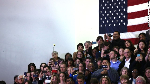 People watch President Obama at Cathedral High School in Boston on April 18.