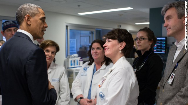 President Barack Obama talks with Massachusetts General Hospital staff on April 18 while visiting patients injured in the terror attack.