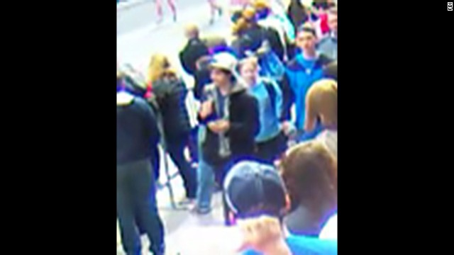 Suspect 2 walks through the crowd. <a href='http://www.cnn.com/SPECIALS/us/boston-bombings-galleries/index.html'>See all photography related to the Boston bombings.</a>