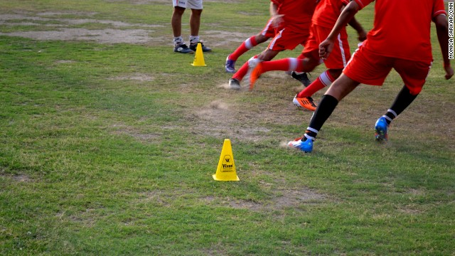 Young players train on the grounds of Steve McMahon Football Academy.