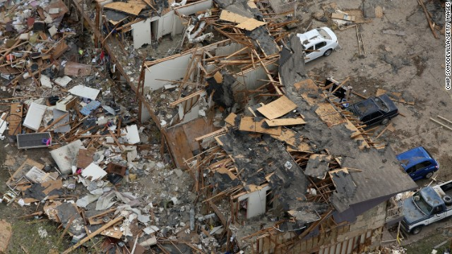 Search and rescue workers comb through what remains of a 50-unit apartment building on April 18.