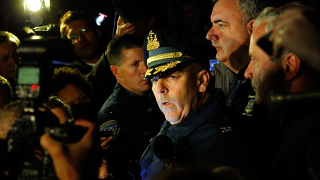 Boston Police Commissioner Edward Davis speaks to the media in Watertown on April 19 and explains that the city is on lockdown until the surviving suspect, Dzhokhar Tsarnaev, is found. The manhunt begins.