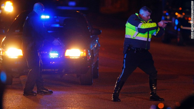 Police officers keep a man on the ground in Watertown on Friday. <a href='http://www.cnn.com/2013/04/19/us/gallery/boston-ghost-town/index.html'>See all photography related to the Boston bombings.</a>